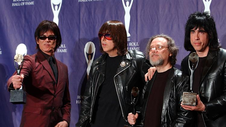 FILE - In this March 18, 2002, file photo, members of the Ramones, from left to right, Dee Dee, Johnny, Tommy and Marky Ramone hold their awards after being inducted at the Rock and Roll Hall of Fame induction ceremony at New York's Waldorf Astoria. A business associate says Tommy, the last surviving member of the original group, has died. Dave Frey, who works for Ramones Productions and Silent Partner Management, says Ramone's wife called to tell him he died on Friday, July 11, 2014. Ramone was 62. (AP Photo/Ed Betz, File)