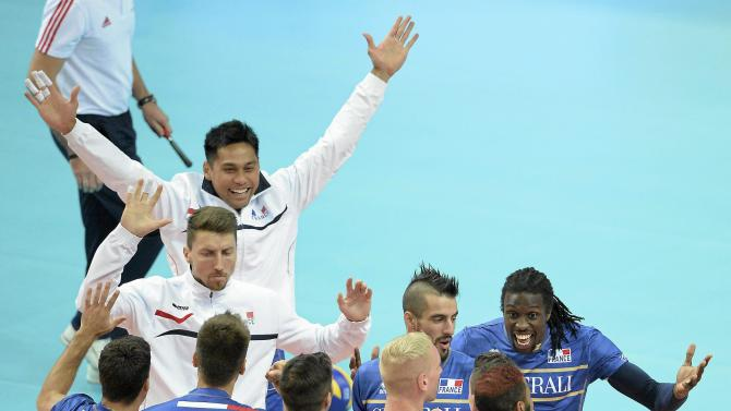 French team celebrates their victory over Germany during their third round match of the FIVB Volleyball Men's World Championship Poland 2014 at the Katowicki Spodek in Katowice