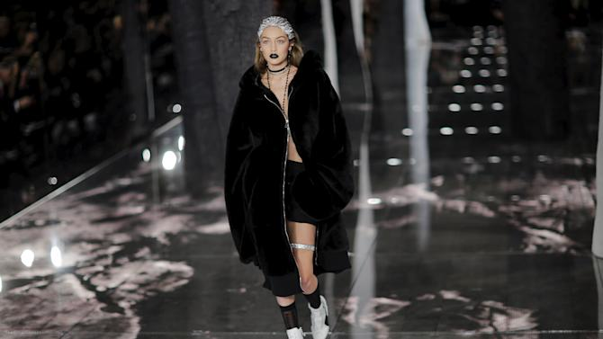 Model Gigi Hadid presents a creation from Fenty PUMA by Rihanna Fall/Winter 2016 collection during New York Fashion Week in New York