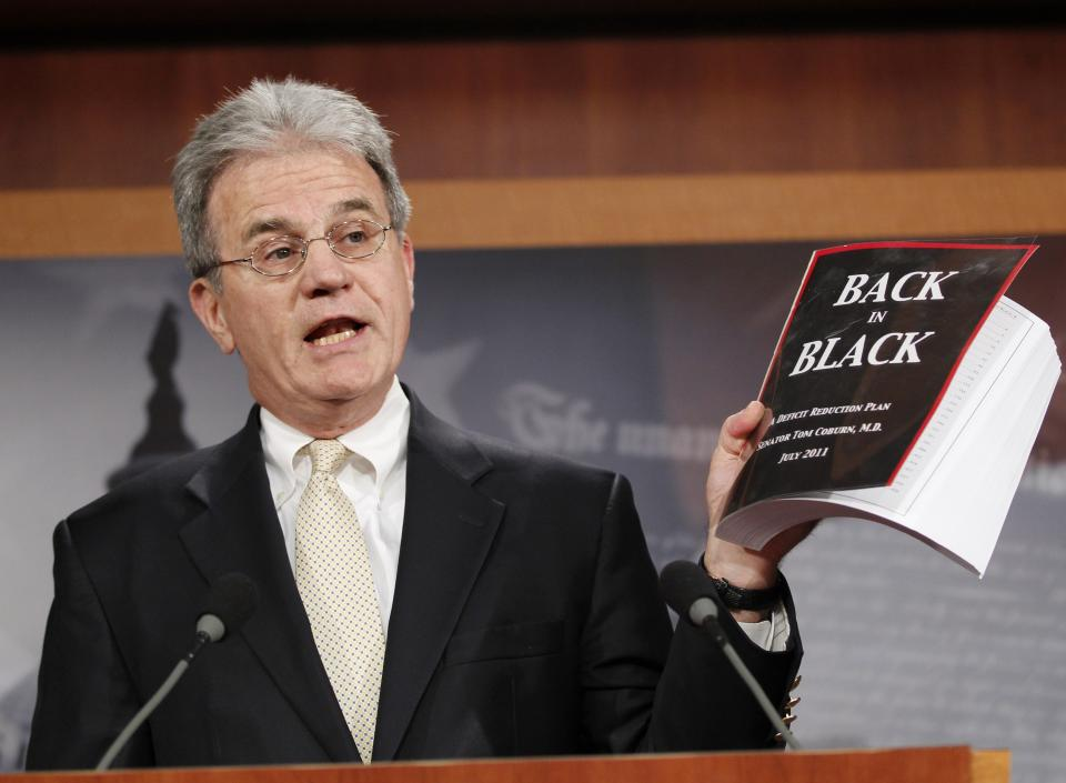 "Sen. Tom Coburn, R-Okla. reveals his ""Back in Black"" plan to reduce the federal deficit, Monday, July 18, 2011, during a news conference on Capitol Hill in Washington. (AP Photo/J. Scott Applewhite)"