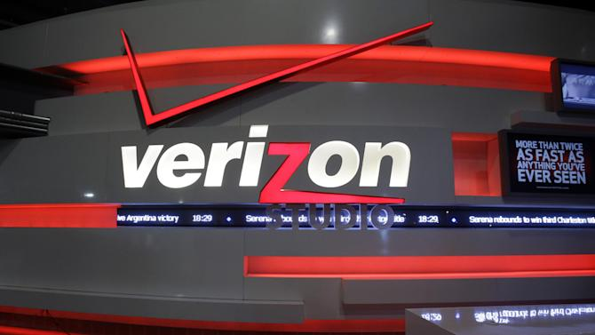 In this Sunday, April 7, 2013, photo, a Verizon Studio booth is seen at MetLife Stadium, in East Rutherford, N.J.  Verizon Communications Inc. on Thursday, April 18, 2013 said that its profit rose 16 percent in the latest quarter as wireless revenue kept rising at a rate that's the envy of the industry.The New York-based phone company reported net income of $1.95 billion, or 68 cents per share, in the January to March period. That was up from $1.69 billion, or 59 cents per share, a year earlier. (AP Photo/Mel Evans)