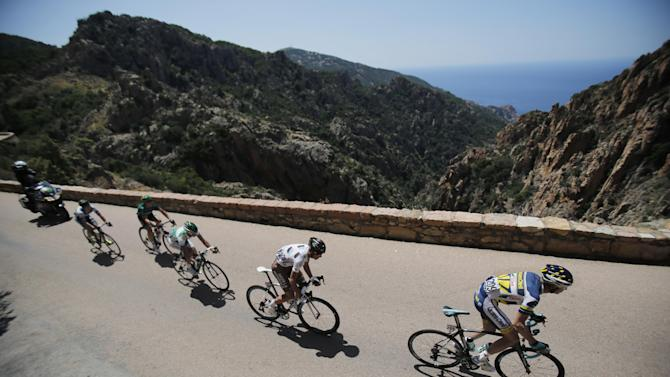The breakaway group with Lieuwe Westra of The Netherlands, Sebatien Minard of France, Alexis Vuillermoz of France, Cyril Gautier of France and Simon Clarke of Australia, from right to left, pass rock formations near Piana during the third stage of the Tour de France cycling race over 145.5 kilometers (91 miles) with start in Ajaccio and finish in Calvi, Corsica island, France, Monday July 1, 2013. (AP Photo/Christophe Ena)