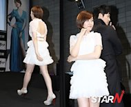 Sung Yuri draws people&#39;s attention in a white flare dress
