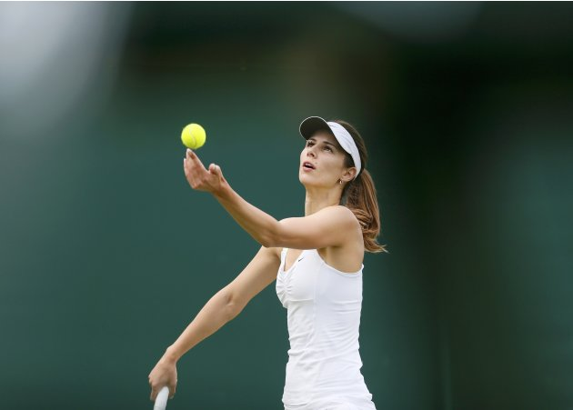 Tsvetana Pironkova of Bulgaria serves to Anastasia Pavlyuchenkova of Russia in their women's singles tennis match at the Wimbledon Tennis Championships, in London