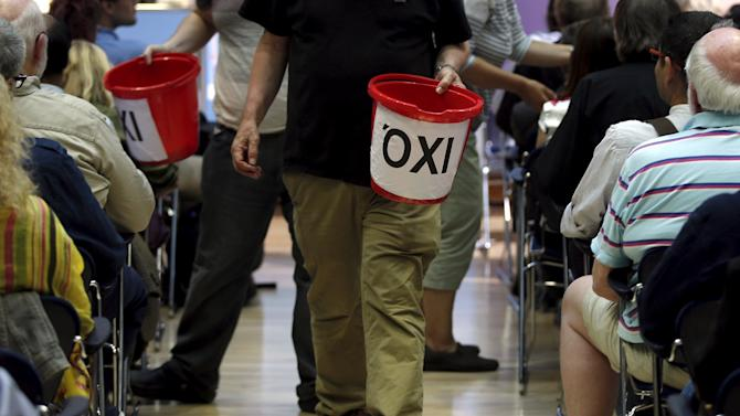 Volunteers make a collection for the Greek Solidarity Campaign, during a rally in support of Greece at the TUC's Congress House, in London