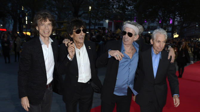 """IMAGE DISTRIBUTED FOR BFI - From left, Mick Jagger, Ronnie Wood, Keith Richards and Charlie Watts, of The Rolling Stones, pose at the London Film Festival American Express Gala for """"Crossfire Hurricane""""  at Odeon West End on Thursday October 18, 2012  in London. (Photo by Jon Furniss/Invision for BFI/AP Images)"""