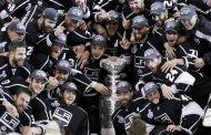 Los Angeles Kings players pose with the Stanley Cup after they defeated the New Jersey Devils in Game 6 of the NHL Stanley Cup hockey final in Los Angeles