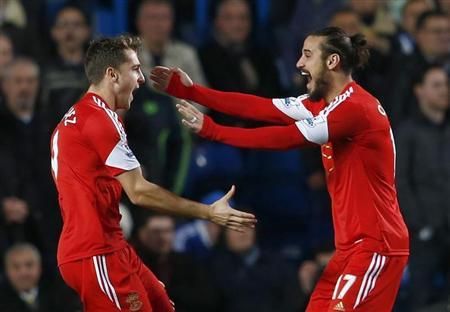 Southampton's Rodriguez celebrates with team mate Osvaldo after scoring a goal against Chelsea during their English Premier League soccer match at Stamford Bridge in London