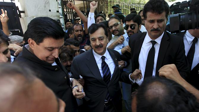 Pakistan's former Prime Minister Yousaf Raza Gilani leaves after the Islamabad High Court granted him the pre-arrest protective bail in Islamabad