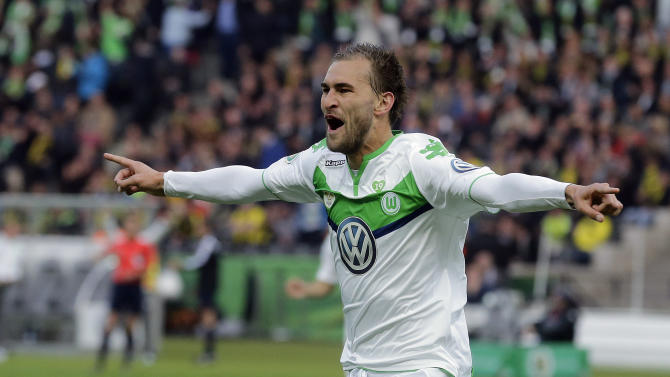 Wolfsburg's Bas Dost from the Netherlands celebrates after scoring  during the German soccer cup final match between Borussia Dortmund and VfL Wolfsburg in Berlin, Germany, Saturday, May 30, 2015. (AP Photo/Markus Schreiber)