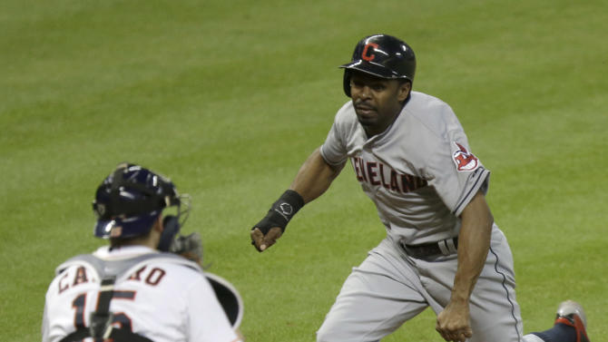 Cleveland Indians' Michael Bourn, right, heads for home plate as Houston Astros catcher Jason Castro (15) waits for the ball in the ninth inning of a baseball game Thursday, Sept. 18, 2014, in Houston. Bourn was tagged out by Castro as he slid past the plate. (AP Photo/Pat Sullivan)
