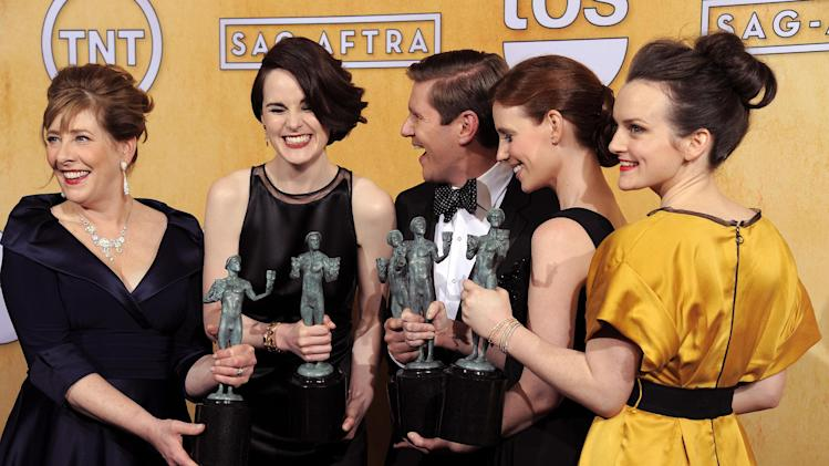 "Actors, from left, Phyllis Logan, Michelle Dockery, Allen Leech, Amy Nuttall and Sophie McShera pose backstage with the award for best ensemble in a drama series for ""Downton Abbey"" at the 19th Annual Screen Actors Guild Awards at the Shrine Auditorium in Los Angeles on Sunday Jan. 27, 2013. (Photo by Chris Pizzello/Invision/AP)"