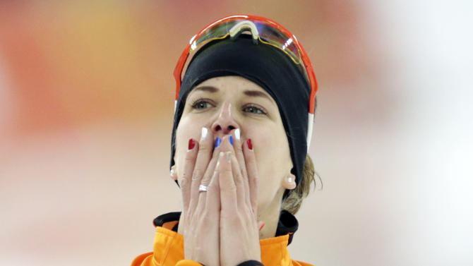 Ireen Wust of the Netherlands celebrates after winning gold in the women's 3,000-meter speedskating race at the Adler Arena Skating Center during the 2014 Winter Olympics, Sunday, Feb. 9, 2014, in Sochi, Russia. (AP Photo/Matt Dunham)