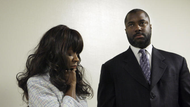 Rev. Jynona Norwood, left, and her attorney Vernon Goins II are shown at Alameda County Superior Court in Oakland, Calif., Thursday, May 12, 2011. Norwood, who lost 27 relatives in the 1978 Jonestown tragedy, appeared Thursday in court in an attempt to block further construction and use of the memorial to the 918 victims that includes the name of Peoples Temple leader Jim Jones at Evergreen Cemetery in Oakland. (AP Photo/Jeff Chiu)