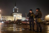 Interior Ministry members stand guard in front of the train station where a bomber detonated explosives in Volgograd December 29, 2013. REUTERS/Sergei Karpov