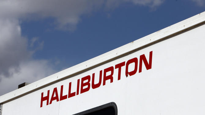 FILE - In this April 15, 2009, file photo, the Halliburton sign adorns the side of a machine being used by the company at a site for natural-gas producer Williams in Rulison, Colo. Halliburton reports quarterly earnings on Monday, Oct. 21, 2013. (AP Photo/David Zalubowski, File)