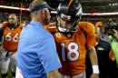 Denver Broncos quarterback Peyton Manning (18) greets San Diego Chargers coach Mike McCoy after an NFL football game, Thursday, Oct. 23, 2014, in Denver. The Broncos won 35-21. (AP Photo/Joe Mahoney)