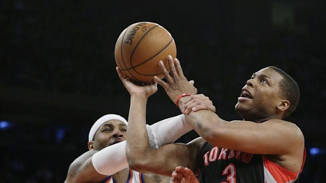 Toronto Raptors' Kyle Lowry (3) is fouled by New York Knicks' Carmelo Anthony (7) during the second half of an NBA basketball game Wednesday, Feb. 13, 2013, in New York. The Raptors won 92-88. (AP Photo/Frank Franklin II)