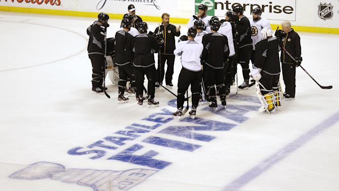 Boston Bruins players gather on the ice during an optional work out at NHL hockey practice in Boston, Tuesday, June 18, 2013. The Bruins lead the Chicago Blackhawks 2-1 in the best-of-seven games series in the Stanley Cup Finals. Game 4 is scheduled for Wednesday in Boston. (AP Photo/Charles Krupa)