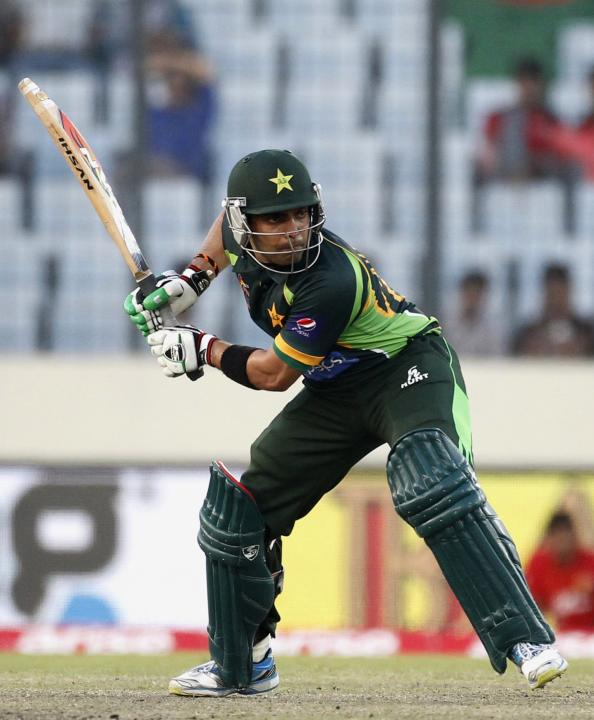 Pakistan's Umar Akmal plays a ball against Sri Lanka during their 2014 Asia Cup final match in Dhaka