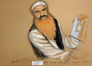A courtroom sketch by artist Janet Hamlin shows alleged 9/11 mastermind Khalid Sheikh Mohammed holding up a piece of paper during a court recess in Guantanamo Bay, Cuba. Long-delayed efforts to try KSM and four Al-Qaeda co-defendants finally got under way Monday with a pre-trial hearing