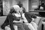This June 20, 1984, file photo, shows from left, Morris Gibb, Dolly Parton, and Robin Gibb, on ABC-TV&#39;s &quot;Good Morning America Show&quot; in New York. A representative said on Sunday, May 20, 2012, that Robin Gibb has died at the age of 62. (AP Photo/Mario Suraini)