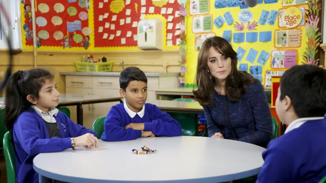 Britain's Catherine, Duchess of Cambridge sits with schoolchildren during the filming for Children's Mental Health Week