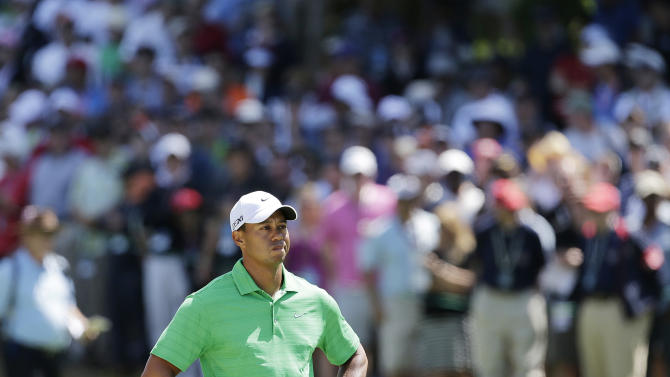 Tiger Woods looks over his shot on the first hole during the third round of the U.S. Open Championship golf tournament Saturday, June 16, 2012, at The Olympic Club in San Francisco. (AP Photo/Eric Gay)