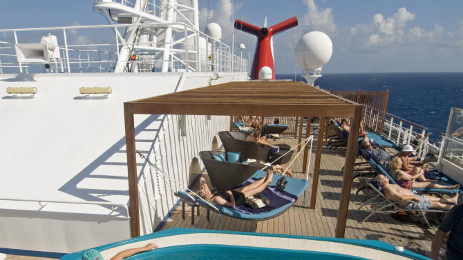 "In this Dec. 13, 2011 photo provided by Carnival Cruise Lines, guests aboard the Carnival Liberty relax in an adults-only areas. Multi-generational groups are a growing segment of cruise passengers. To accommodate the diverse needs of old and young passengers, ships are expanding areas for youth activities while at the same time creating more adult-only pools and quiet areas where adult passengers can nap, sun, or read a book. Carnival ships call these areas ""Serenity Spaces.""  (AP Photo/Carnival Cruise Lines, Andy Newman)"