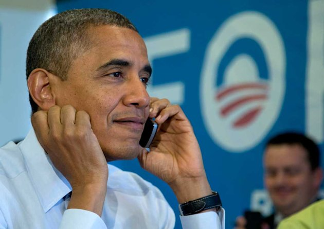 President Barack Obama calls volunteers as he visits a campaign office call centre on the day of the 2012 election
