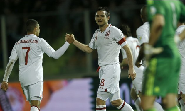 England's Frank Lampard celebrates his goal against San Marino with Alex Oxlade-Chamberlain during their 2014 World Cup qualifying soccer match at the Serravalle Stadium in San Marino