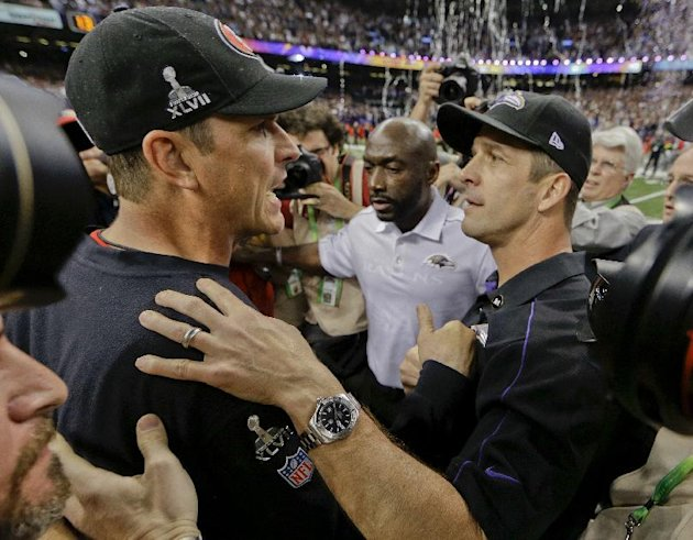 San Francisco 49ers head coach Jim Harbaugh, left, greets Baltimore Ravens head coach John Harbaugh after the Ravens defeated the 49ers 34-31 in the NFL Super Bowl XLVII football game, Sunday, Feb. 3,