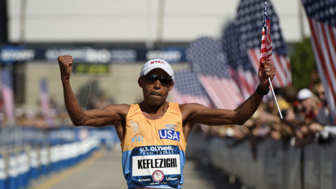 Meb Keflezighi reacts as he passes the finish line during the U.S. Olympic marathon trials, Saturday, Feb. 13, 2016, in Los Angeles. (AP Photo/Kelvin Kuo)