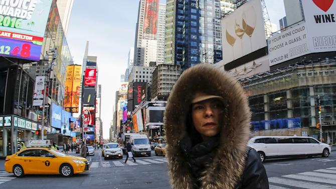 A woman is seen bundled up from the cold in Times Square, NewYork