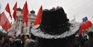 Russian opposition supporters protest in Saint Petersburg against Prime Minister Vladimir Putin&#39;s expected return to the Kremlin. Elsewhere in Russia, thousands of Russians have linked hands around Moscow in a protest against Putin&#39;s expected victory in the presidential elections on March 4