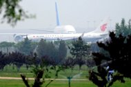 A China Southern Airline plane and an Air China plane are seen taxiing for take-off at the Beijing Capital International airport, on June 7. The debt crisis in Europe and high oil prices weigh on the outlook for airlines as they meet from June 10 in Beijing for the annual meeting of the International Air Transport Association (IATA)