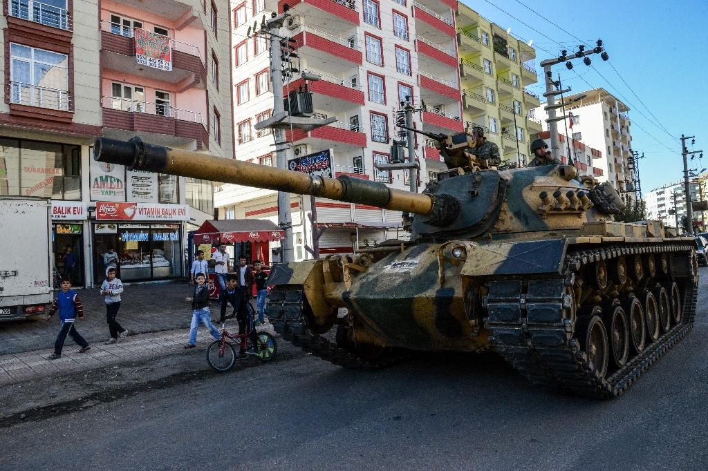 Turkey PM threatens military action against Syrian Kurds