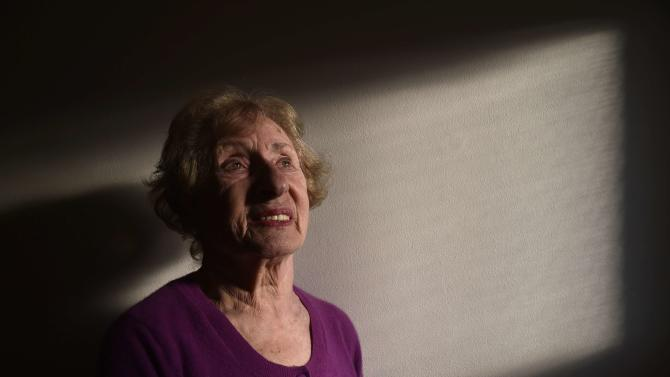 Auschwitz survivor, 84-year-old Susan Pollack, poses at her house in London