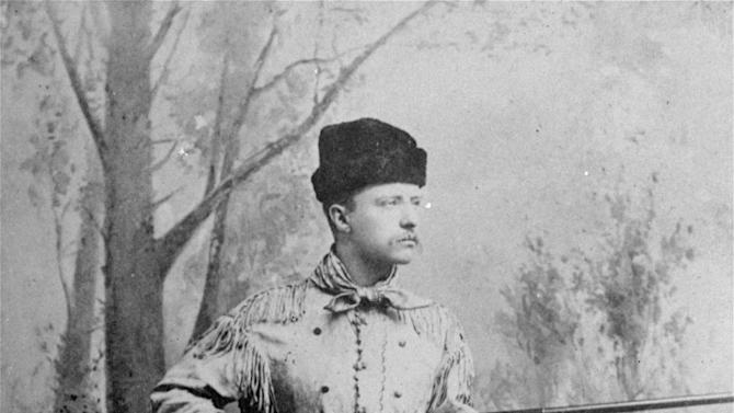 "FILE - In this undated file photo provided by Harvard University Press, President Theodore Roosevelt, posing as an ""outdoorsman,"" points his rifle during a studio photo session. The White House has released a photo of President Barack Obama firing a gun, two days before he is set to travel to Minnesota to discuss gun control. It shows Obama shooting at clay targets on the range at Camp David, the presidential retreat in Maryland, where he says he engages in the sport ""all the time."" The image was released at a time when Obama is pushing a package of gun-control measures in response to the Newtown, Conn., school shooting. But the image of a U.S. president holding a gun is certainly nothing new.  (AP Photo/Harvard University Press, File)"