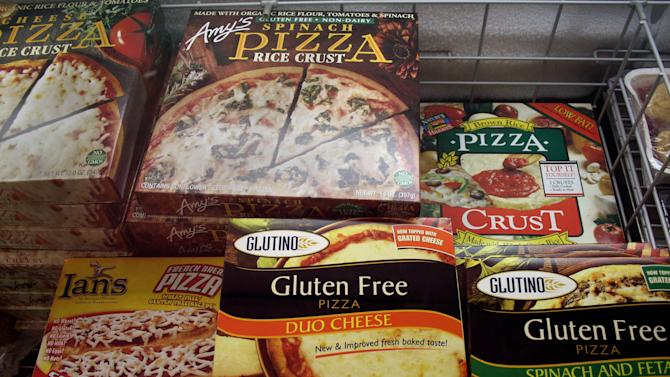 FILE - This Nov. 11, 2008, file photo, shows gluten-free frozen pizza, just one of hundreds of items at Gluten Free Trading Co. in Milwaukee. Schools, restaurants and anyone else serving food are more vulnerable to legal threats over food sensitivities after the Justice Department determined that severe food allergies can be classified as disabilities under federal law. People who suffer from celiac disease don't absorb nutrients well and can get sick from the gluten found in wheat, rye and barley. Celiac is a diagnosed illness that is more severe than gluten sensitivity, which some people self-diagnose. Millions of people are buying gluten free foods because they say they make them feel better, even if they don't have a wheat allergy. (AP Photo/M.L. Johnson, File)