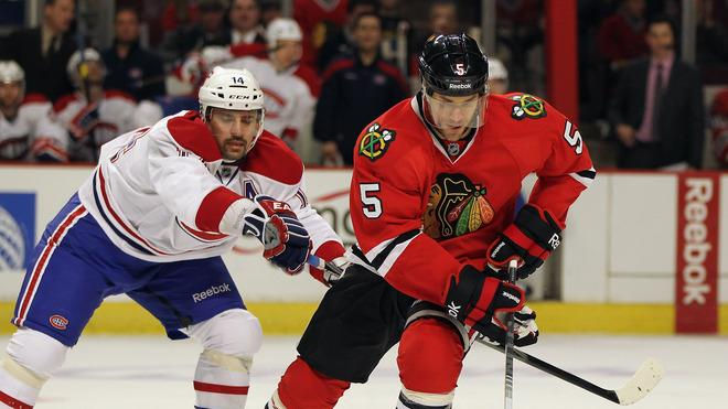 Steve Montador #5 Of The Chicago Blackhawks Controls Getty Images