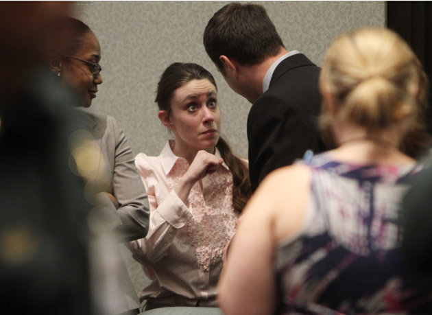 Casey Anthony talks with a supporter in court following the end of her  murder trial where she was acquitted of murder charges in  Orlando, Fla. Tuesday, July 5, 2011. Anthony had been charged with ki