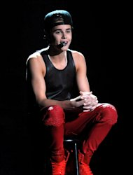 FILE - In this Nov. 18, 2012 file photo, Justin Bieber performs at the 40th Anniversary American Music Awards, in Los Angeles. The Los Angeles City Attorney's Office appealed on Wednesday Dec. 12, 2012 a criminal court judge's ruling tossing anti-paparazzi counts against a photographer charged with driving recklessly in pursuit of Bieber. (Photo by John Shearer/Invision/AP, File)