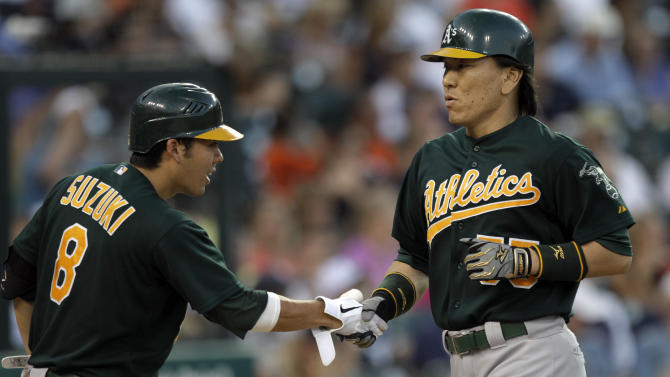 Oakland Athletics designated hitter Hideki Matsui, of Japan, right, is congratulated by Kurt Suzuki (8) after hitting a solo home run during the sixth inning of a baseball game against the Detroit Tigers, Wednesday, July 20, 2011, in Detroit. (AP Photo/Paul Sancya)