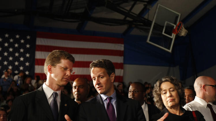 FILE - In this Wednesday, Feb. 18, 2009, file photo, from left, Housing and Urban Development Secretary Shaun Donovan, Treasury Secretary Timothy Geithner, and Federal Deposit Insurance Corporation (FDIC) Chair Sheila Bair talk prior to President Barack Obama delivering remarks about the home mortgage crisis, at Dobson High School in Mesa, Ariz. Under Geithner, Treasury fell far short of the administration's goals of helping up to 9 million homeowners at risk of losing homes to foreclosure.  Geithner's critics say he rejected suggestions that the programs require mortgage servicers to provide loan modifications. (AP Photo/Gerald Herbert)