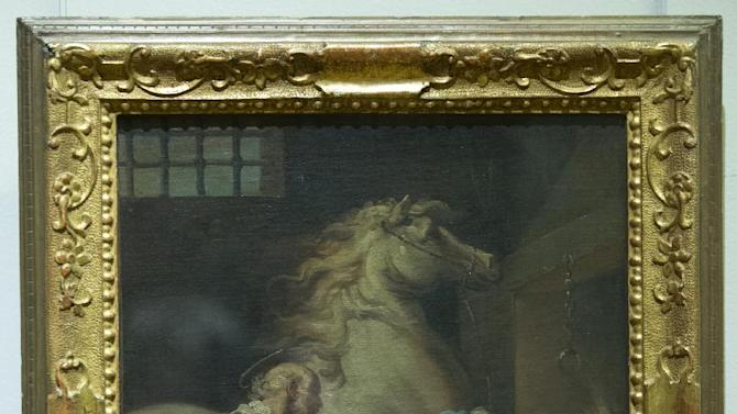 """The painting """"Miracle de la Saint Eloi"""" by Gaetano Gandolfi San Matteo della Decima (1734-1802) is seen at the Louvre museum in Paris, Thursday, Feb. 14, 2013. The French state is preparing to give back seven stolen Nazi-era paintings - 4 of which including """"Miracle de la Saint Eloi"""" are in the Louvre - to two Jewish families, after a decade-long tug of war. It ends years of struggle for the two families, whose claims were all validated by the French prime minister last year. (AP Photo/Jacques Brinon)"""