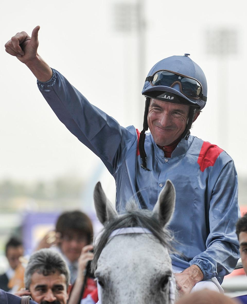 Adrie De Vries celebrates after he wins the Dubai Kahayla race on TM Fred Texas from U.S., Saturday, March 31, 2012, in Dubai, United Arab Emirates. (AP Photo/Stephen Hindley)