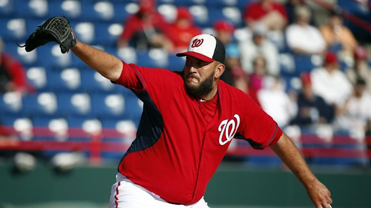 Washington Nationals relief pitcher Tyler Robertson (45) throws in a spring exhibition baseball game against the Houston Astros, Friday, March 7, 2014, in Viera, Fla. The Nationals won 8-5. (AP Photo/Alex Brandon)