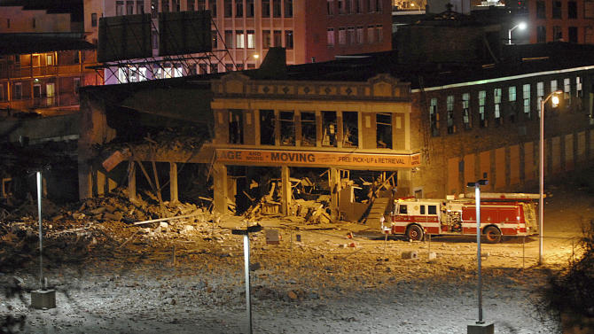 A firetruck is parked next to a damaged building after a nearby gas explosion leveled another building in downtown Springfield, Mass. on Friday, Nov. 23, 2012. (AP Photo/Springfield Republican, David Molnar)   MANDATORY CREDIT