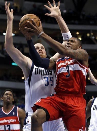 Kaman 23 points as Mavs beat Wizards 107-101